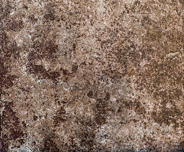 Azulejo de cerâmica marrom com padrão de superfície de pedra abstrata áspera