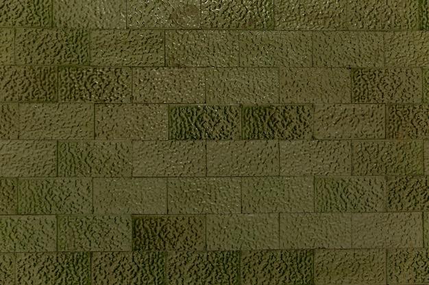 Azulejos verdes decorativos na parede. fundo. espaço para texto.