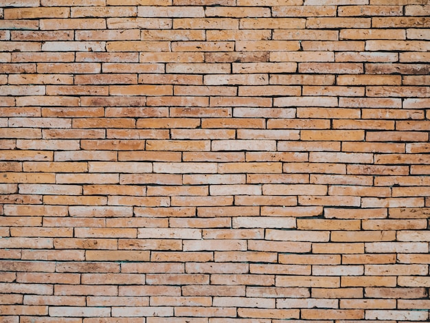 Backrgound de parede de tijolo de tom laranja