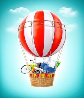 Balão de ar quente colorido com passaportes, passagens, mala e bicicleta dentro de uma cesta