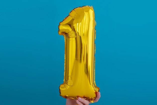 Balão de celebração de número 1 de folha de ouro
