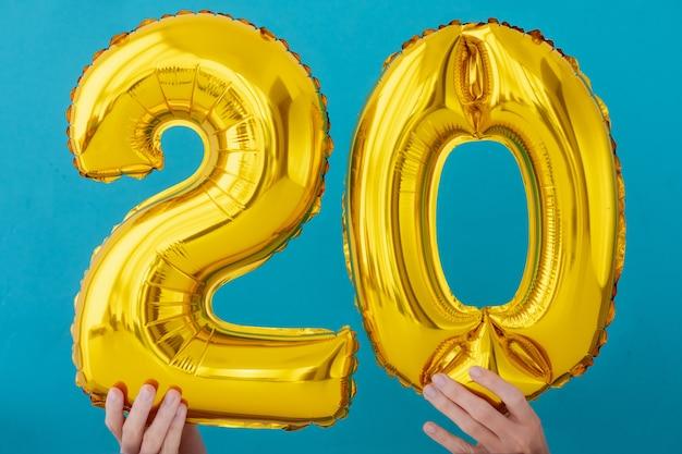 Balão de celebração de número 20 de folha de ouro