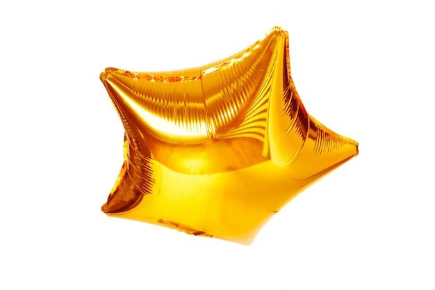 Balão metálico da estrela grande do ouro isolado no branco