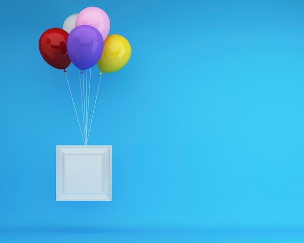 Balões coloridos que flutuam com moldura para retrato branca no fundo azul. idéia de conceito mínimo.