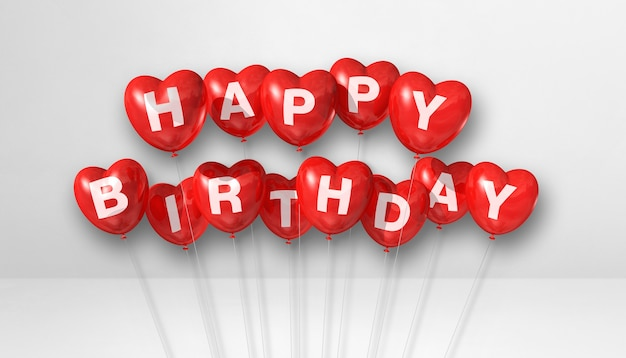 Balões de ar em forma de coração vermelho feliz aniversário em uma cena de superfície branca