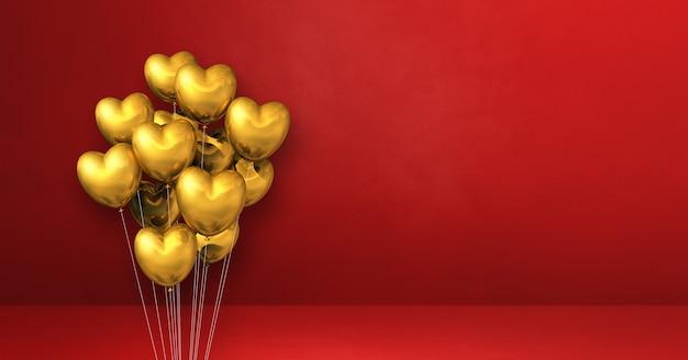 Balões dourados em forma de coração amontoados em uma superfície vermelha