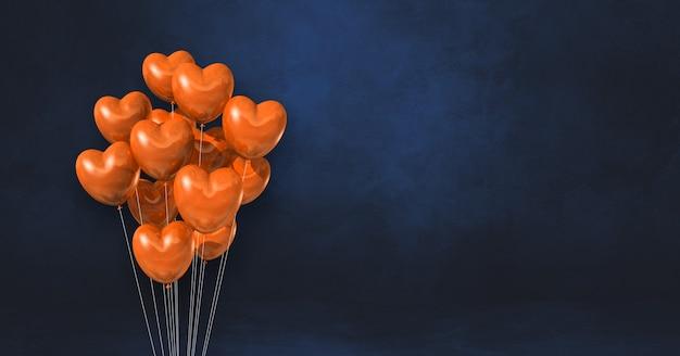 Balões em formato de coração laranja agrupados em uma superfície preta