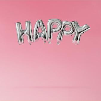 Balões felizes flutuando no pastel rosa.
