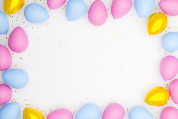 Balões nas cores azul, rosa e dourado colocados em um fundo branco