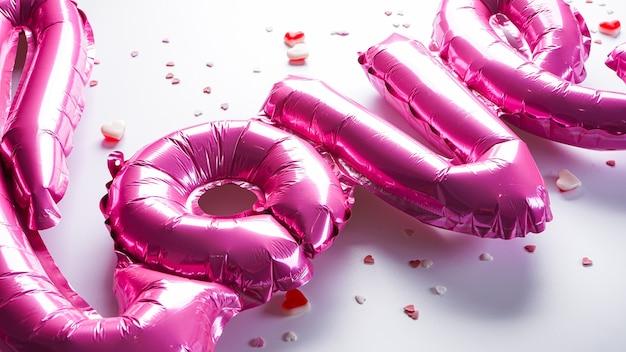 Balões rosa em forma da palavra