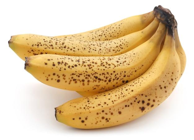 Banana manchada sobre fundo branco
