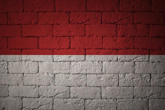 Bandeira com proporções originais. closeup da bandeira do grunge de mônaco