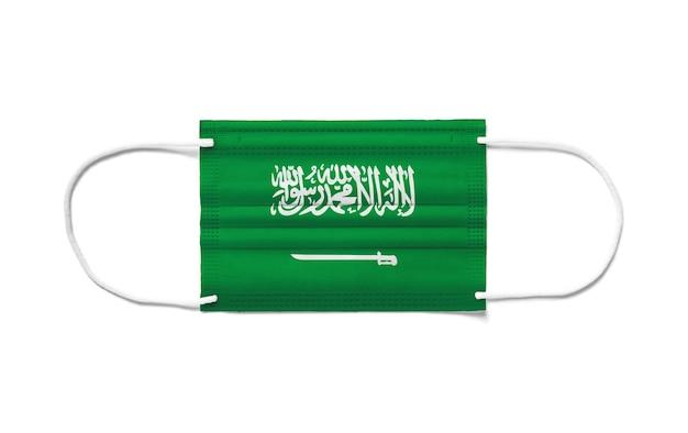 Bandeira da arábia saudita em uma máscara cirúrgica descartável.