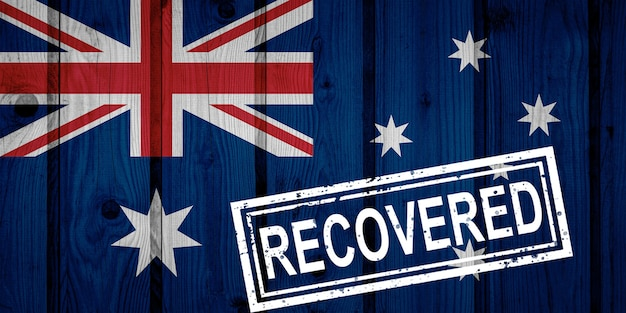 Bandeira da austrália que sobreviveu ou se recuperou das infecções da epidemia do vírus corona ou coronavírus. bandeira do grunge com selo recuperado