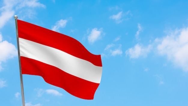 Bandeira da áustria na pole. céu azul. bandeira nacional da áustria