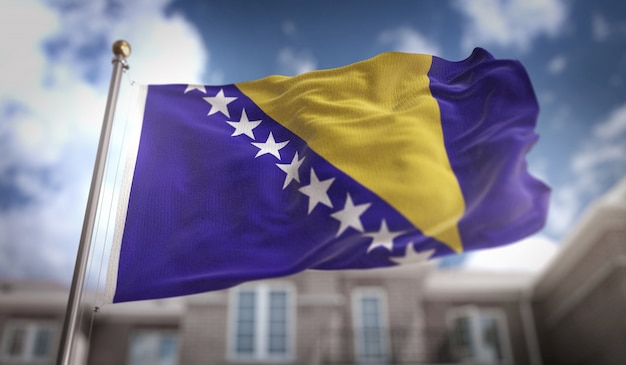 Bandeira da bósnia e herzegovina representação 3d no fundo do edifício do céu azul