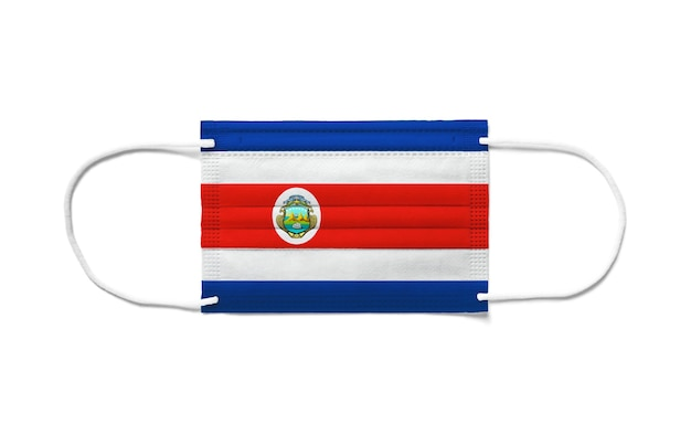 Bandeira da costa rica em uma máscara cirúrgica descartável. superfície branca isolada
