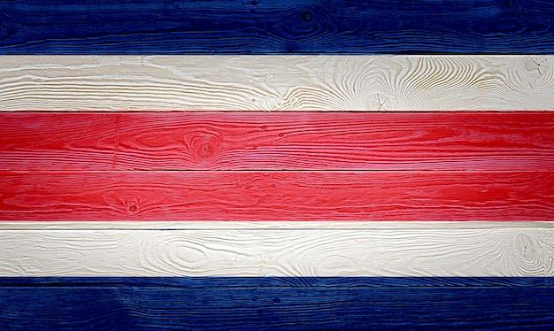 Bandeira da costa rica pintada em fundo de prancha de madeira velha