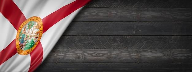 Bandeira da flórida no banner de parede de madeira preta, eua. ilustração 3d