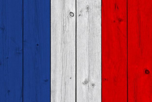 Bandeira da frança pintada na prancha de madeira velha