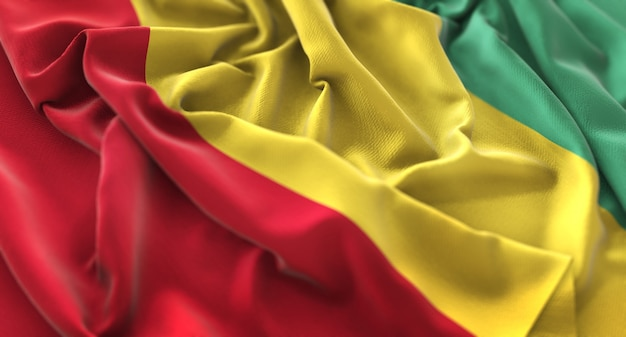 Bandeira da guiné ruffled beautifully waving macro close-up shot