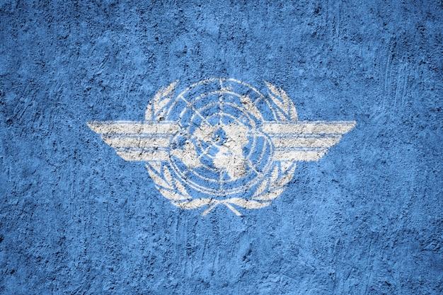 Bandeira da icao pintada na parede do grunge