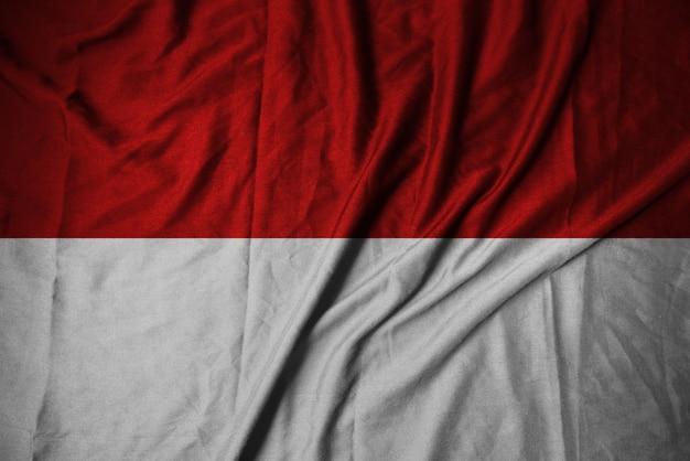 Bandeira da indonésia dramática para o fundo