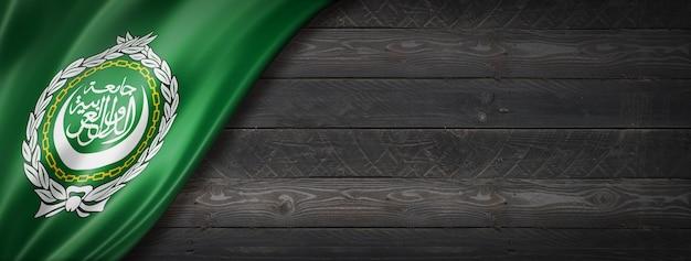 Bandeira da liga árabe na parede de madeira preta