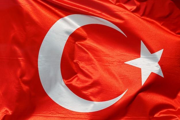 Bandeira da turquia na textura de algodão a acenar.
