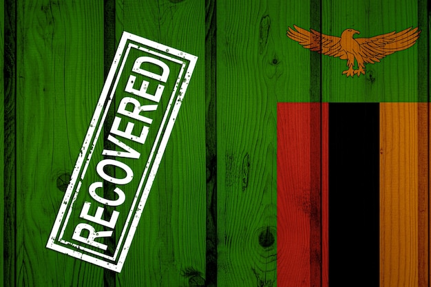 Bandeira da zâmbia que sobreviveu ou se recuperou das infecções da epidemia do vírus corona ou coronavírus. bandeira do grunge com selo recuperado