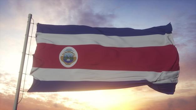 Bandeira das ilhas da costa rica balançando ao vento, o céu e o sol de fundo. renderização 3d.