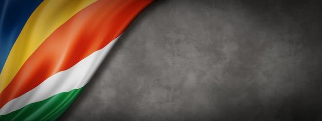 Bandeira das seychelles em banner de parede de concreto
