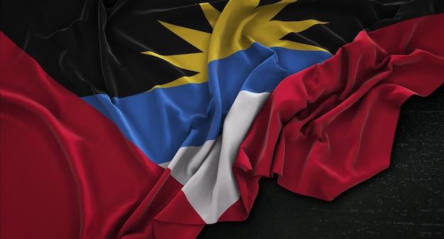 Bandeira de antígua e barbuda enrugada no fundo escuro 3d render