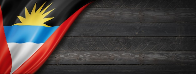 Bandeira de antígua e barbuda na parede de madeira preta