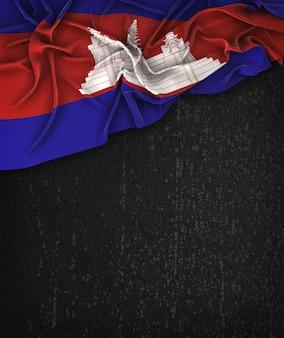 Bandeira de cambodia vintage em um quadro preto de grunge com espaço para texto