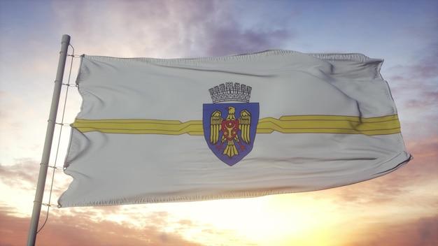 Bandeira de chisinau, capital da república da moldávia balançando ao vento, o céu e o sol de fundo. renderização 3d.