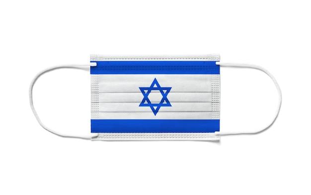Bandeira de israel em uma máscara cirúrgica descartável. fundo branco isolado