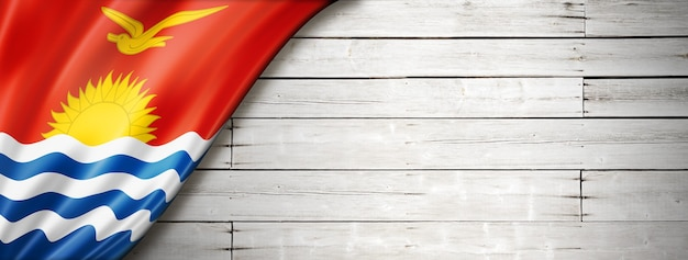 Bandeira de kiribati na velha parede branca. banner panorâmico horizontal.