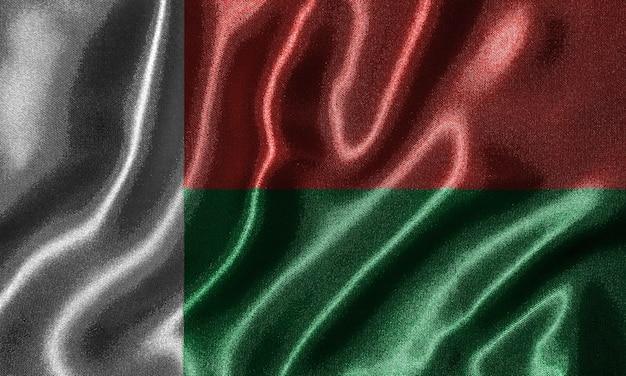 Bandeira de madagascar - bandeira do tecido do país de madagáscar, fundo da bandeira de ondulação.