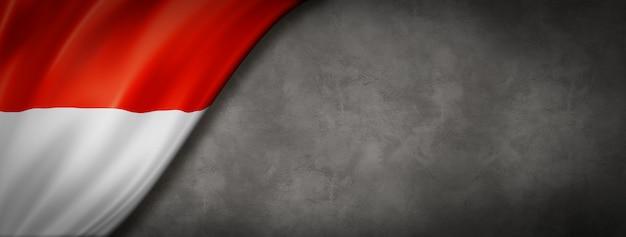 Bandeira de mônaco na parede de concreto
