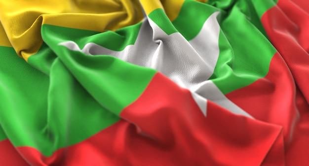 Bandeira de myanmar ruffled beautifully waving macro close-up shot
