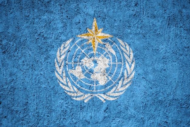 Bandeira de organização meteorológica mundial pintada na parede do grunge
