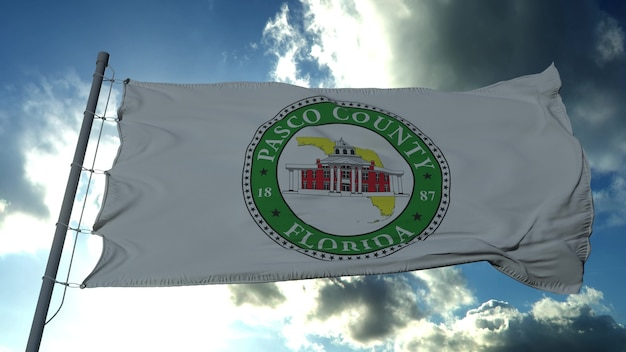 Bandeira de pasco, condado do estado da flórida, estados unidos da américa balançando ao vento no céu azul. renderização 3d
