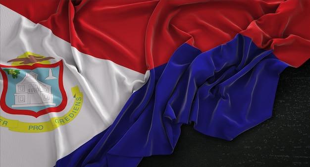 Bandeira de saint martin enrugada no fundo escuro 3d render