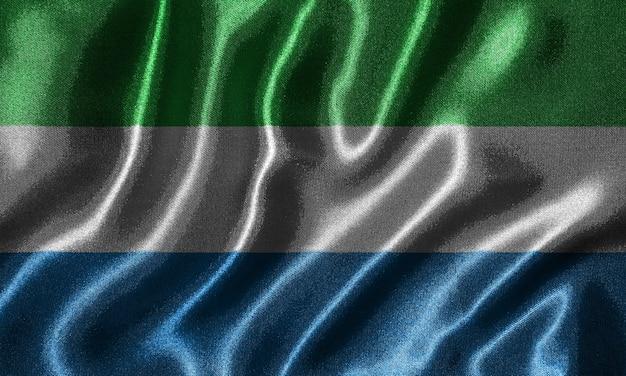 Bandeira de serra leoa - bandeira de tecido do país de serra leoa, fundo da bandeira de ondulação.