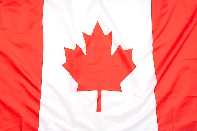 Bandeira de tecido real do canadá como plano de fundo ou textura, vista superior, bandeira do canadá