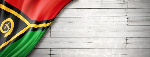 Bandeira de vanuatu na velha parede branca. faixa panorâmica horizontal.