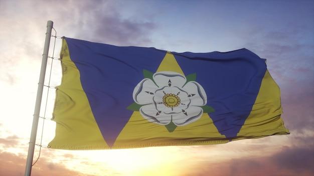 Bandeira de west yorkshire, inglaterra, balançando ao vento, o céu e o sol de fundo. renderização 3d.