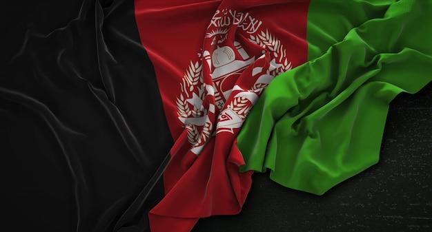 Bandeira do afeganistão enrugada no fundo escuro 3d render