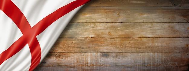 Bandeira do alabama em fundo de madeira velho, eua. ilustração 3d